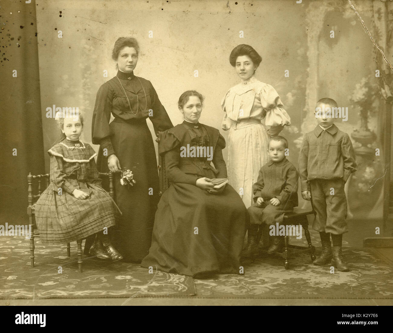 Antique c1900 photograph, mother and children, or mother and children with aunts. SOURCE: ORIGINAL PHOTOGRAPH. Stock Photo