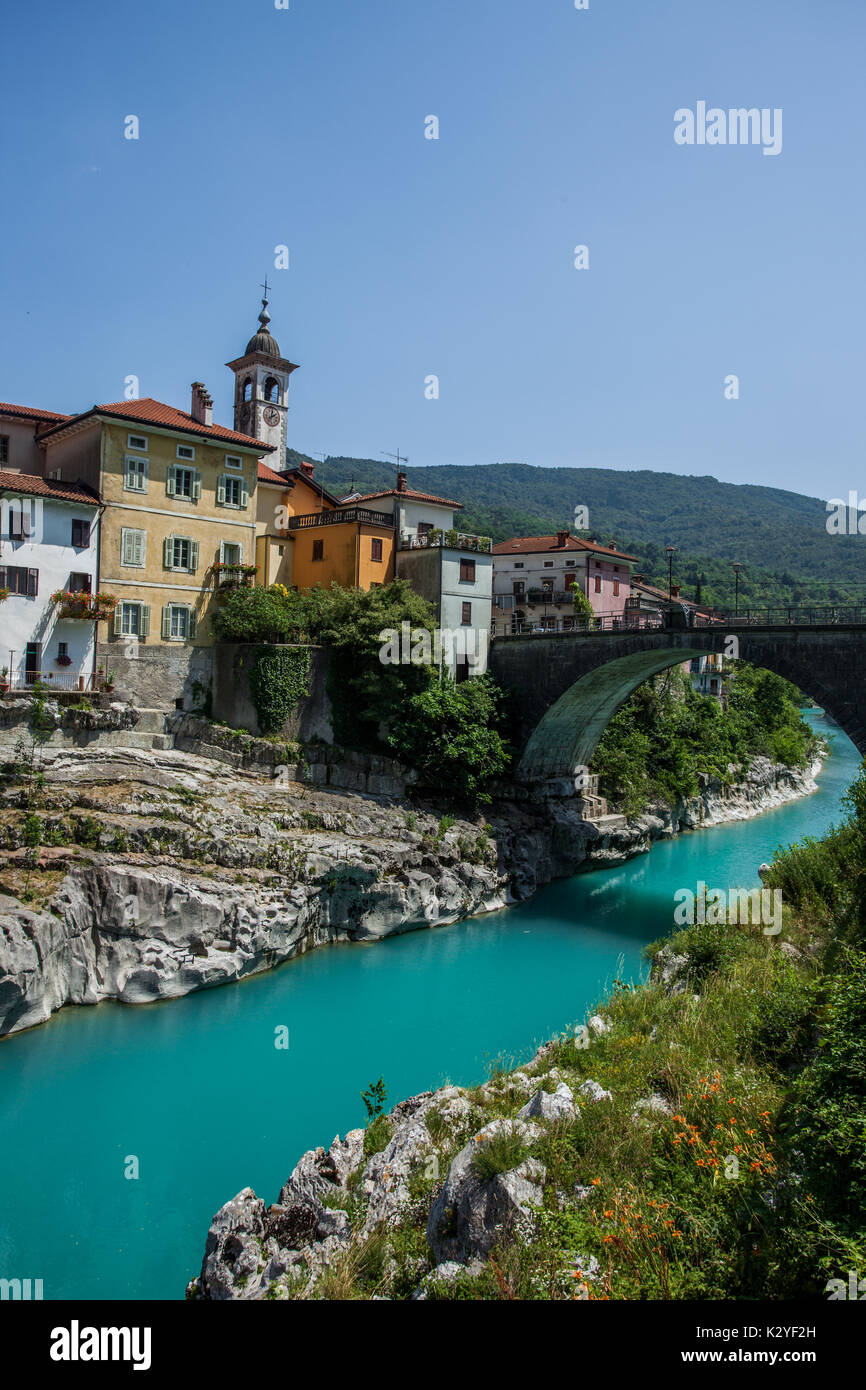 Kanal ob Soči is an old historical town next to the emerald river of Soča in Slovenia. Big bridge is one of the few in this part of the Soča valley. - Stock Image