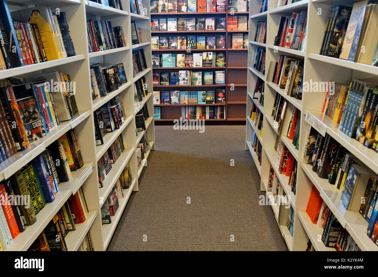 Fiction books aisle with no people in a bookstore, Vancouver, BC, Canada - Stock Image