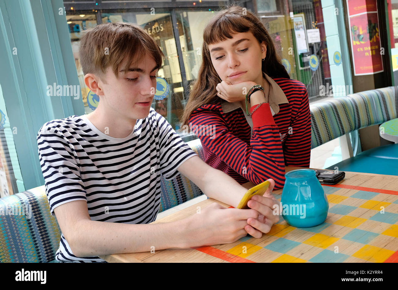 young teenage couple in cafe - Stock Image