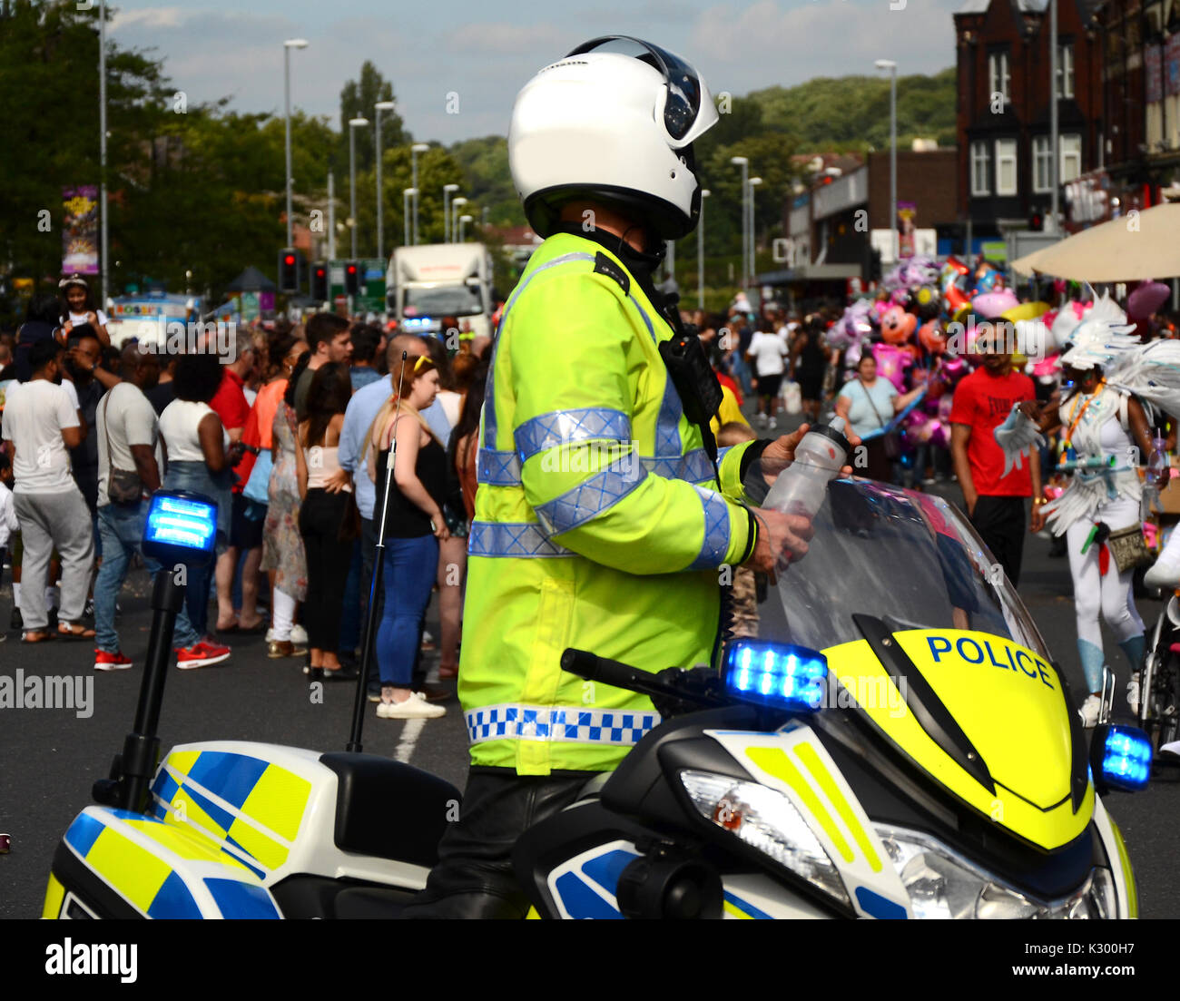 police officer on police motorcycle - Stock Image