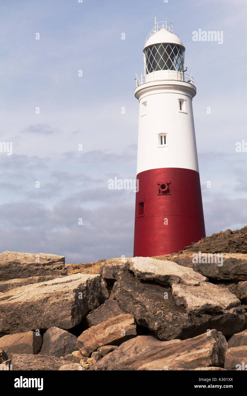 Portland Bill Lighthouse keeping watch over those in peril on the sea. - Stock Image