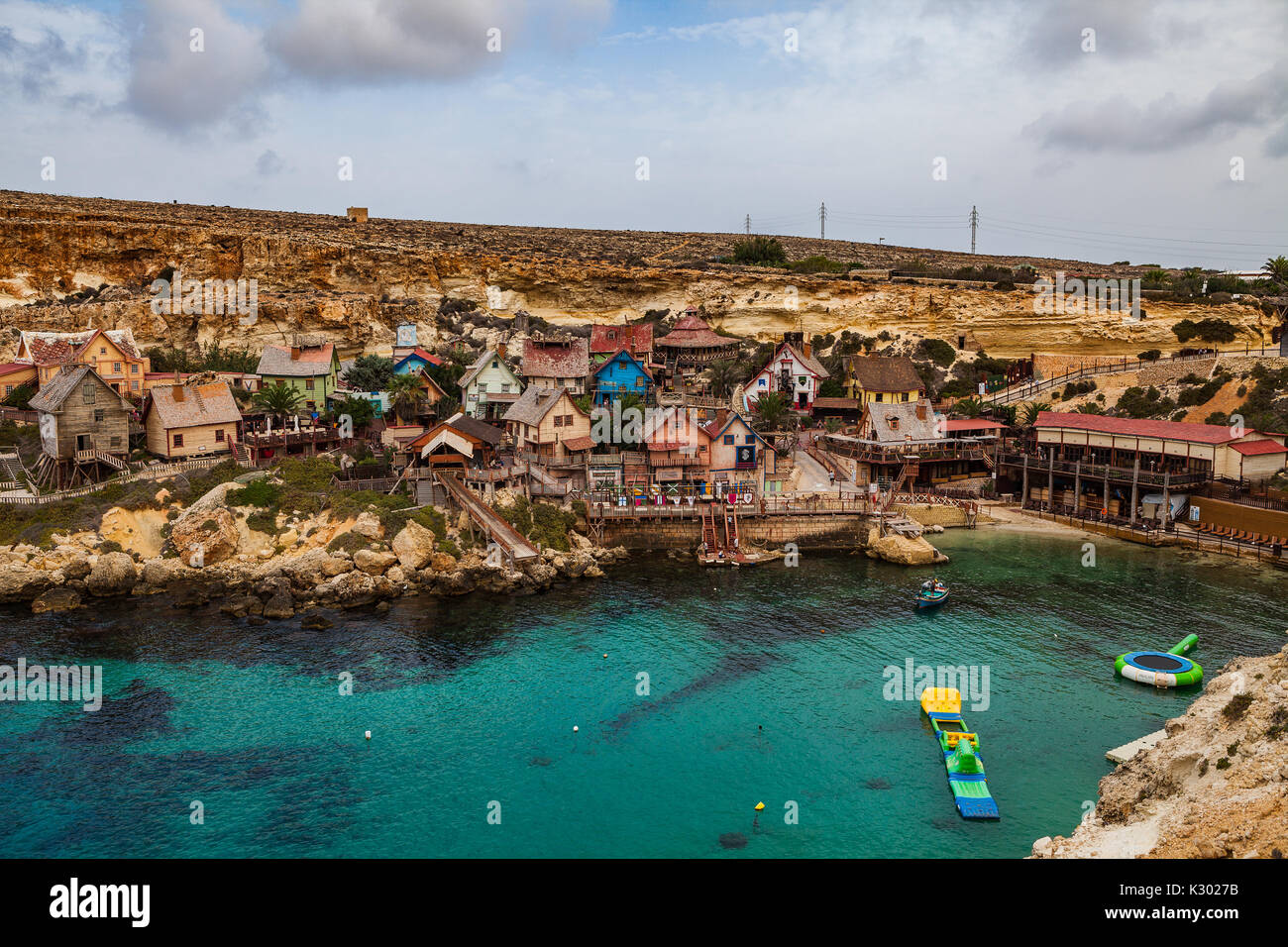 Famous Popeye village in Malta. Azure bay in the rocks. - Stock Image