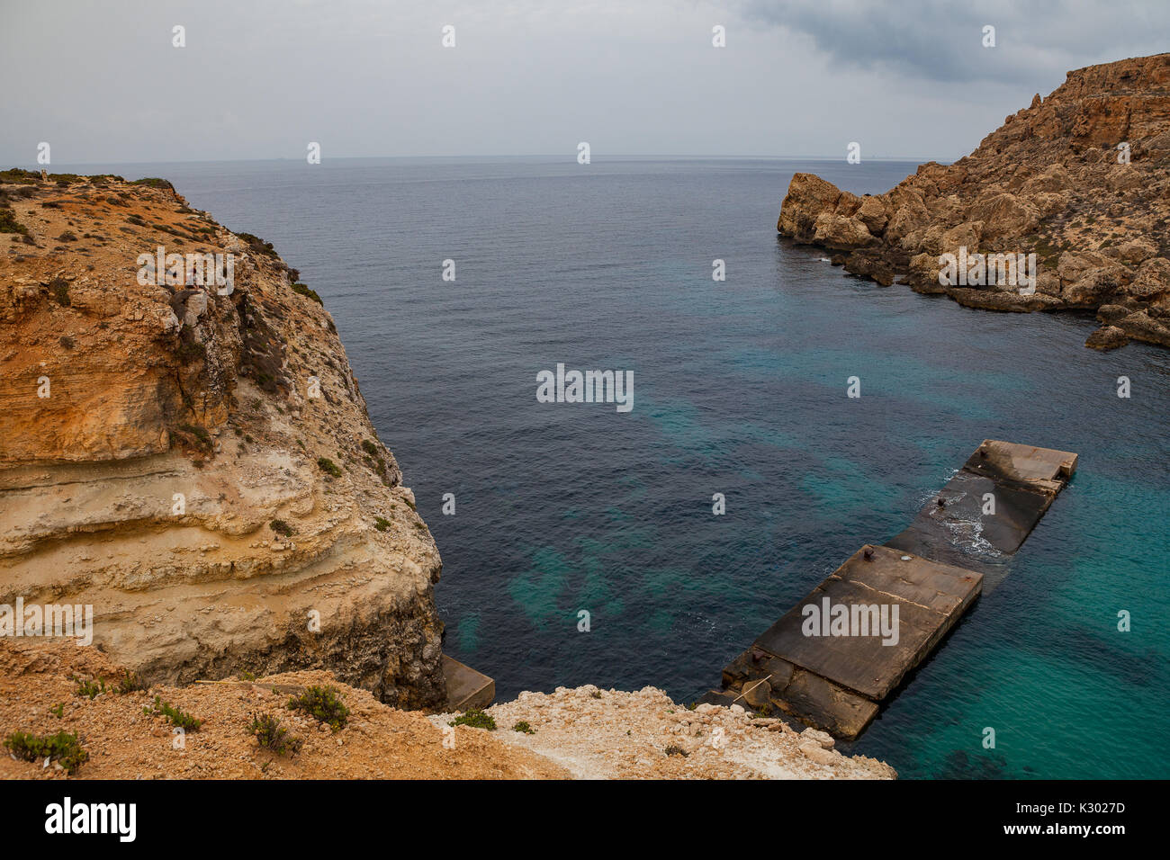 Famous Popeye village in Malta. Azure bay in the rocks. - Stock Image