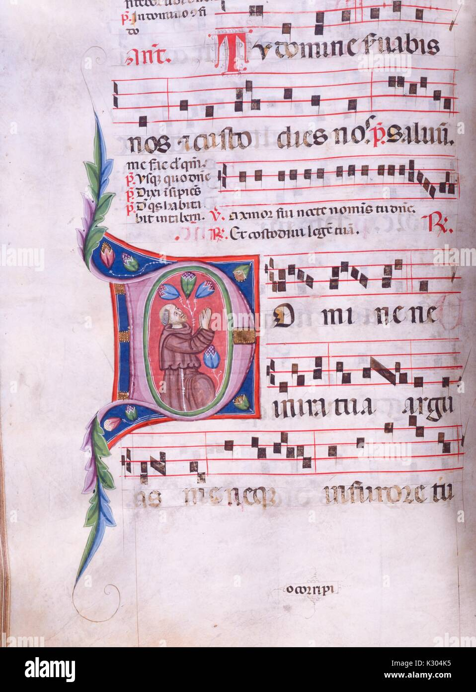 Illuminated manuscript page of song with man rejoicing, from the 'Incipit antiphonarium nocturnum, ' a 15th century Stock Photo