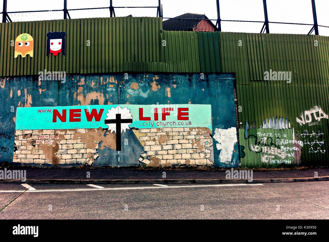 Political graffiti along the peace wall. New Life City Church. Belfast, Northern Ireland, United Kingdom, UK, Europe. - Stock Image