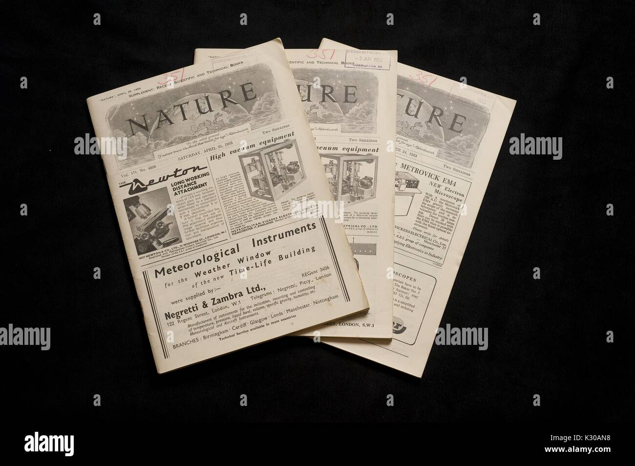 Three issues of Nature magazine containing the articles in which Watson and Crick first revealed the structure of DNA, in the Dr. Elliott and Eileen Hinkes Collection of Rare Books of Scientific Discovery housed in the Sheridan Libraries of Johns Hopkins University, 2010. - Stock Image