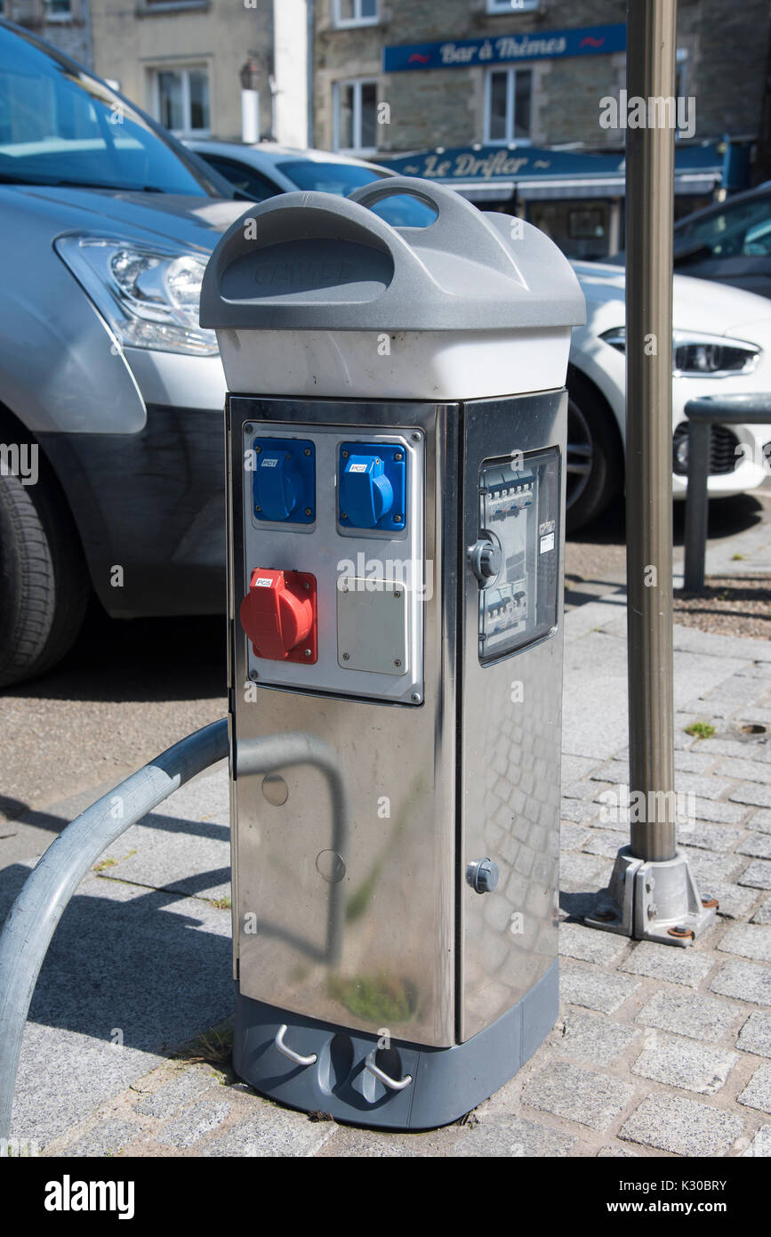 Electric car charging station in the center of Cherbourg in France - Stock Image