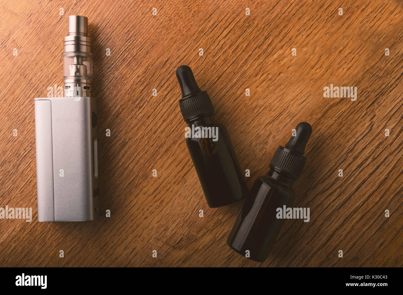 tools for vaping device, electronic cigarette, e-cigarette, box mod, accessories isolated over a wooden background. for vaping shops. - Stock Image