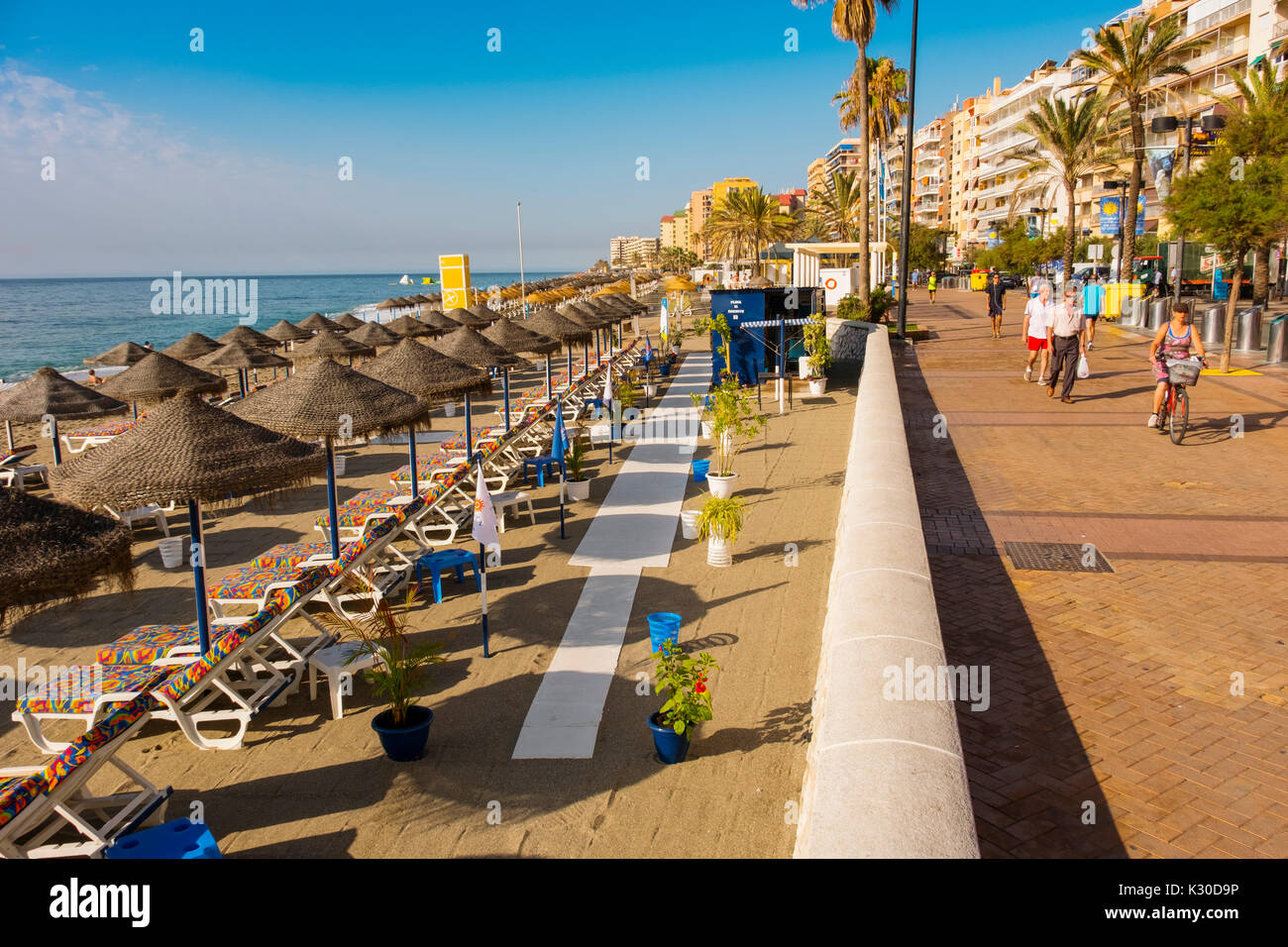 Straw umbrellas & Hammock, beach, Fuengirola. Malaga province Costa del Sol. Andalusia southern, Spain Europe - Stock Image