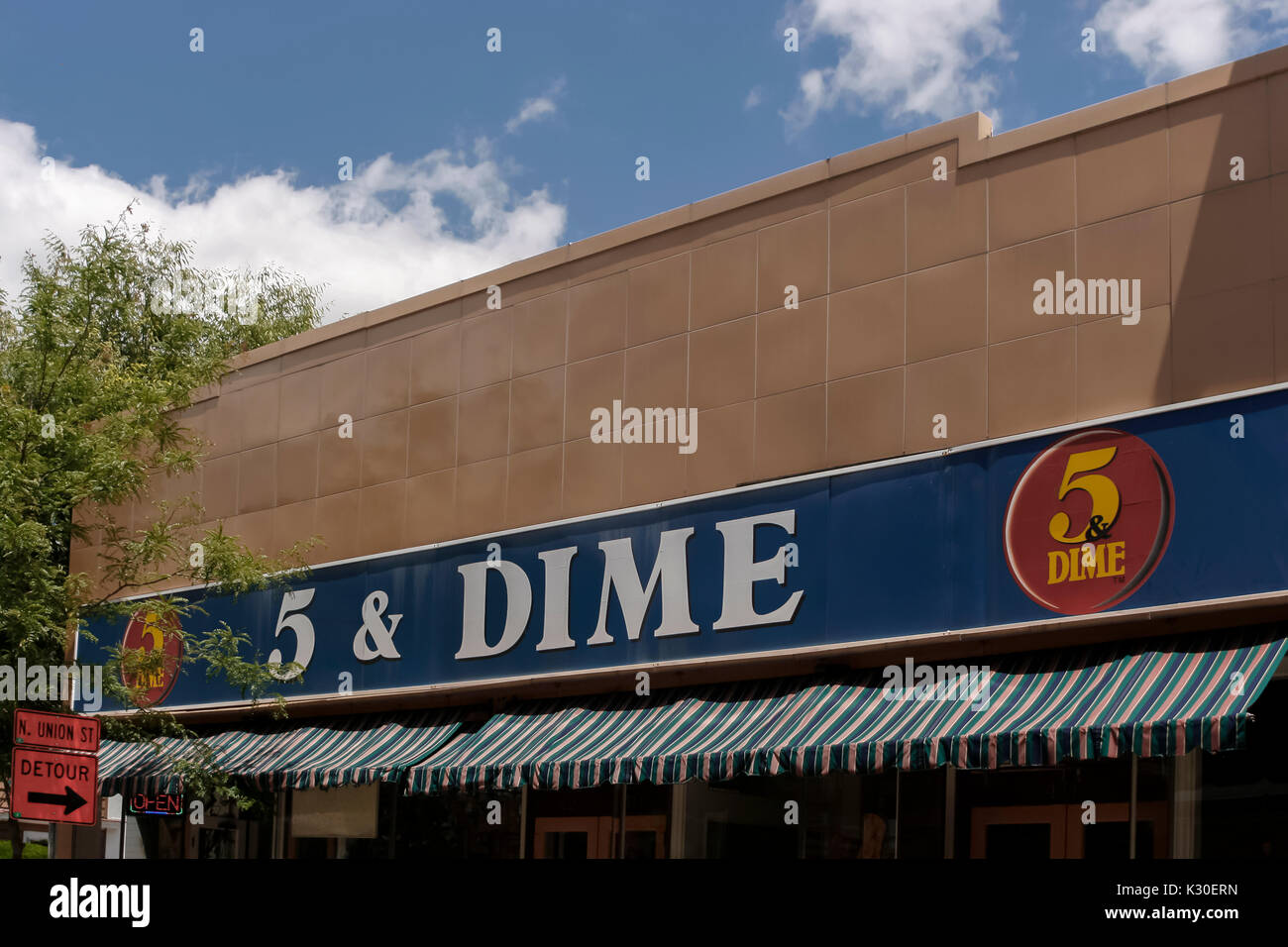 A 5 & Dime store sign still remains from the early 1900s when the store sold many different kind of items which sold for five or ten cents. - Stock Image