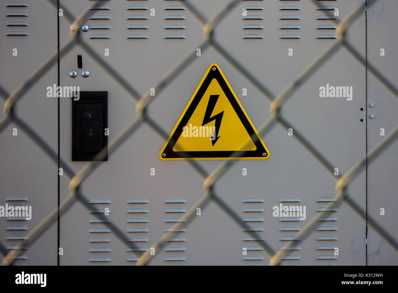 electrical hazard sign placed on a electric power substation behind ...