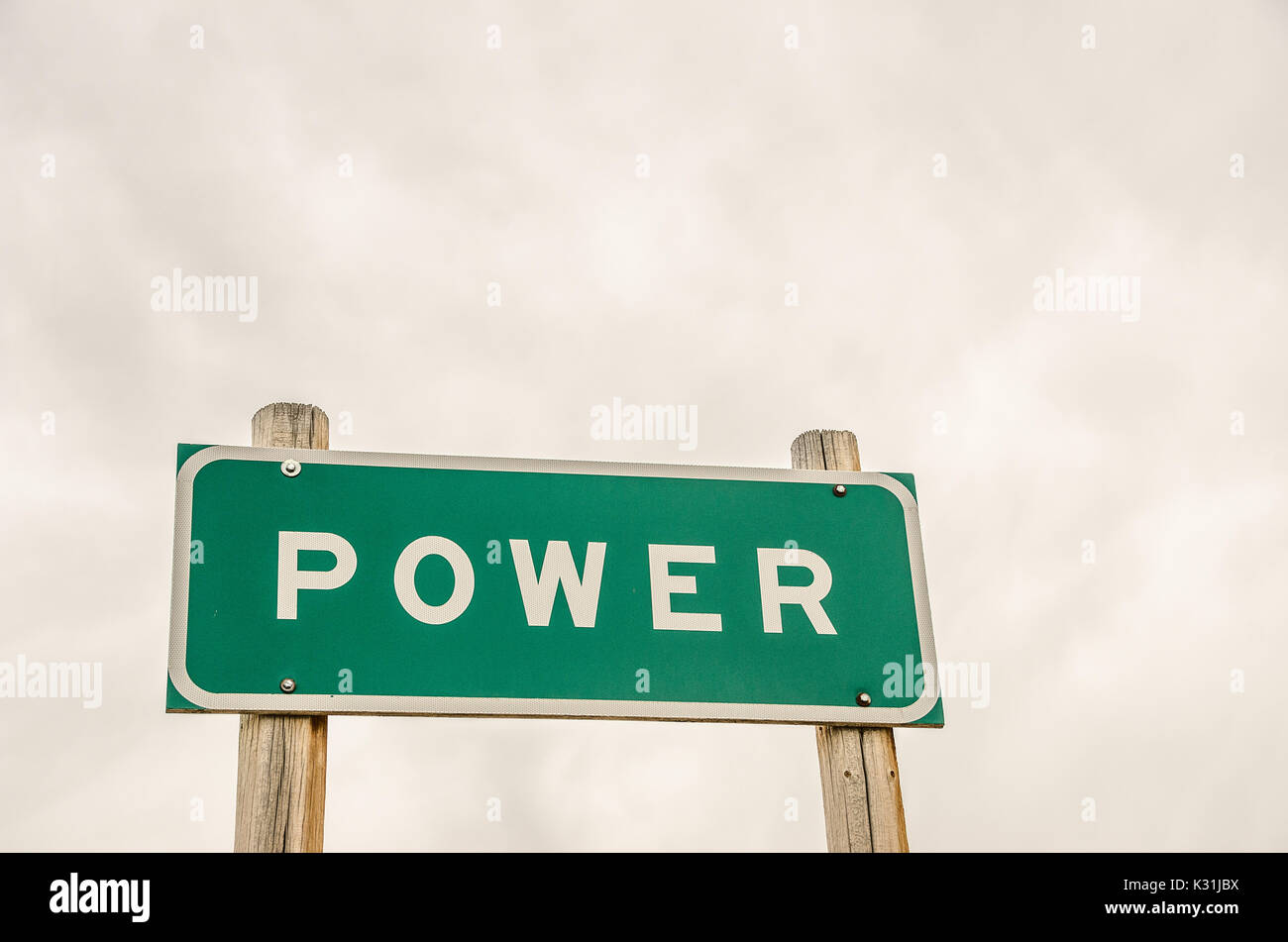 Green and white sign for power representing authority, control, influence, and strength with plenty of room for your message. - Stock Image