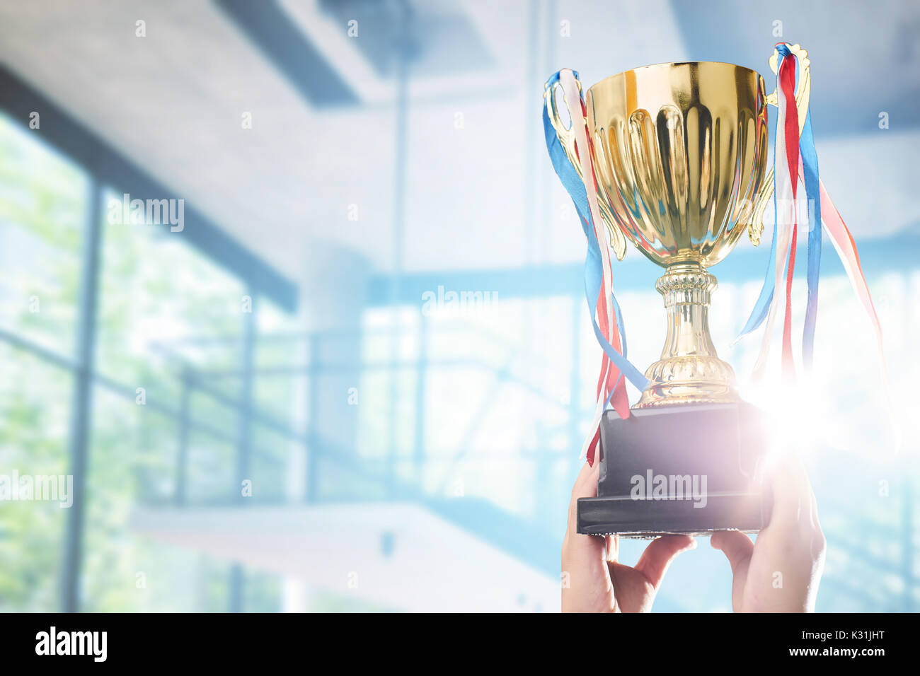Businessman holding award trophy for show their victory. - Stock Image