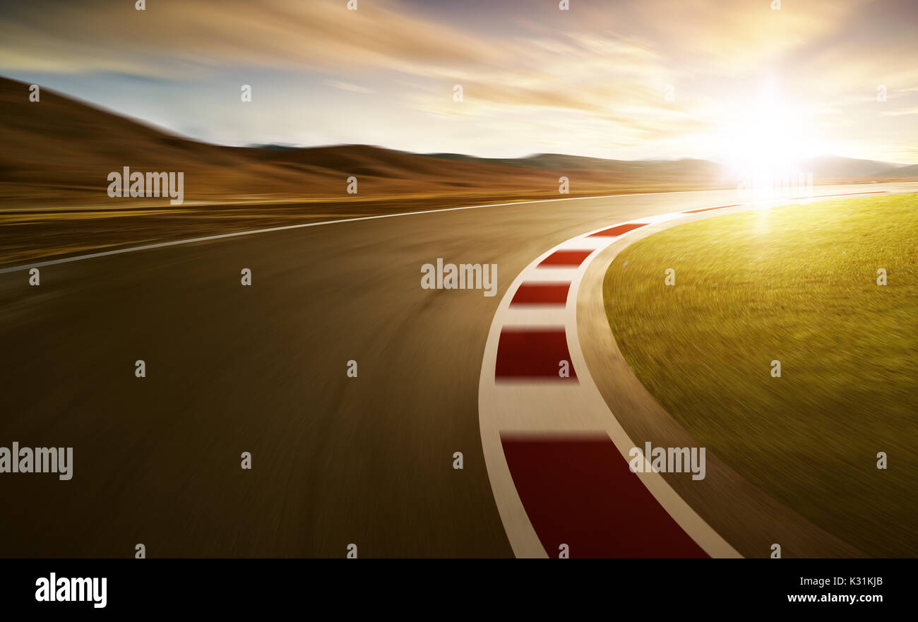 Motion blurred racetrack with mountain background , warm mood - Stock Image