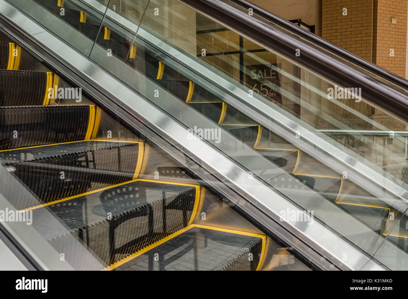 Reflections create an interesting abstract of outdoor escalators - Stock Image
