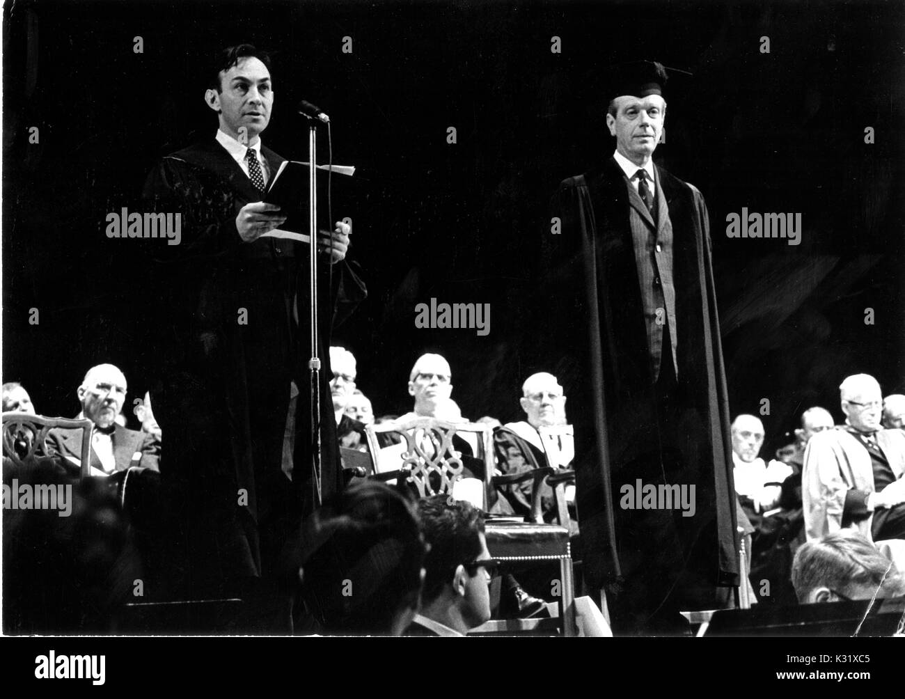 Harry Woolf, department chairman for the History of Science at Johns Hopkins University, presents an award to United States Army officer James McCormack during the university's commemoration day, celebrating the university's founding, in Baltimore, Maryland, February 22, 1966. - Stock Image
