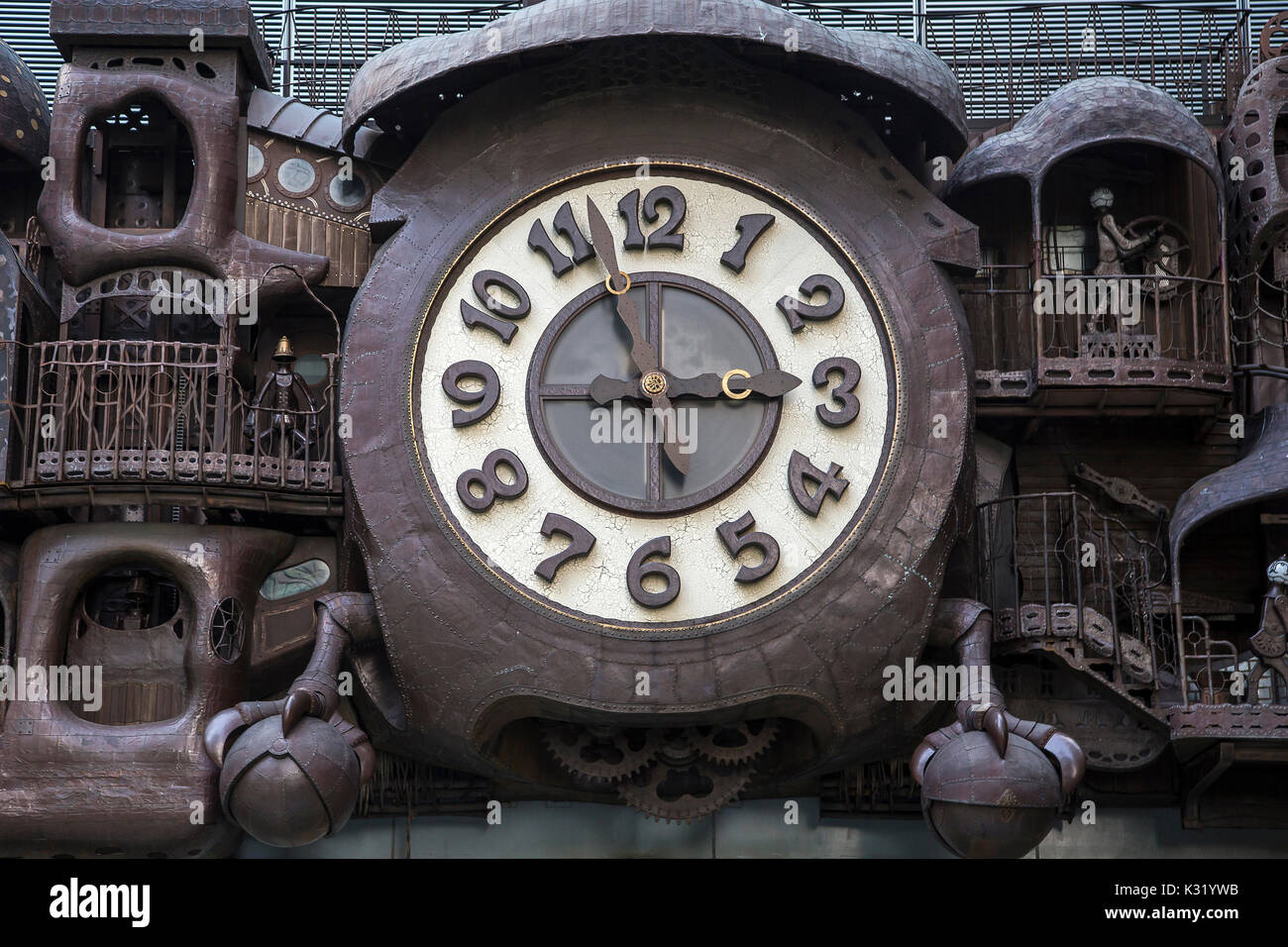 Giant Ghibli Miyazaki Clock -  The sheer size of the giant clock is surprising enough: 60 feet wide and made of over 20 tons of copper and steel.  But - Stock Image