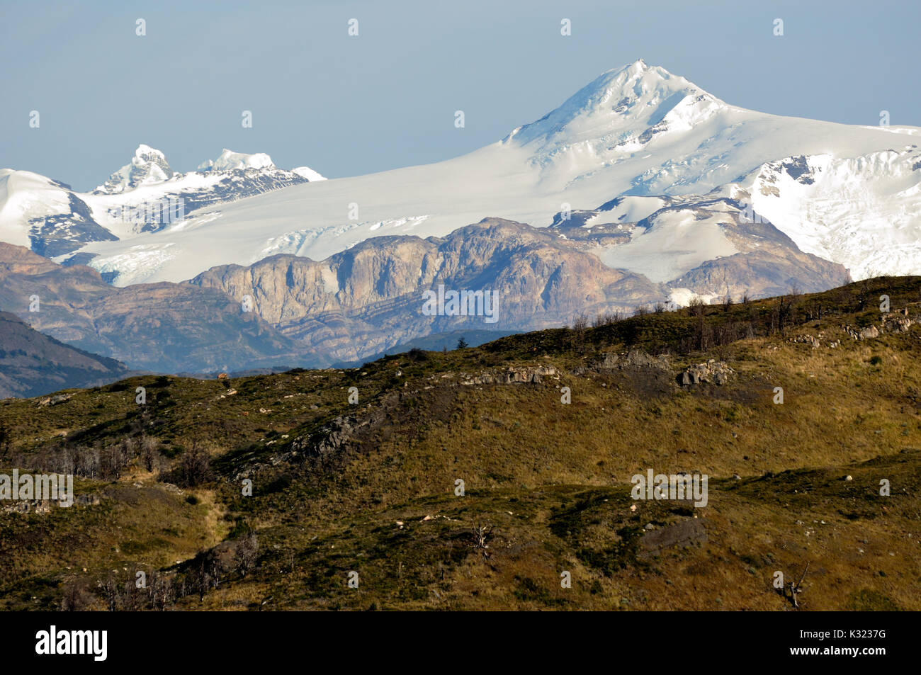 Lonely and seldom visible peaks rise over the Southern Patagonian Ice Field (Campo de hielo patagonico sur) . Seen from Lago Pehoe at Torres del Paine - Stock Image