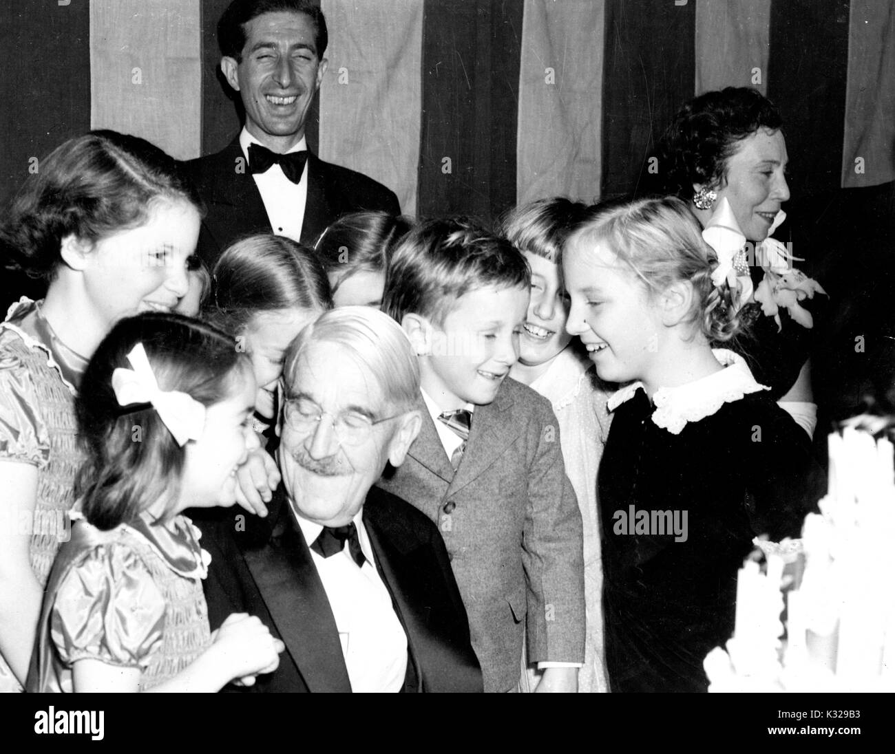 American philosopher, psychologist, and educational reformer John Dewey (front, center) is surrounded by his children, celebrating his 90th birthday, 1949. - Stock Image