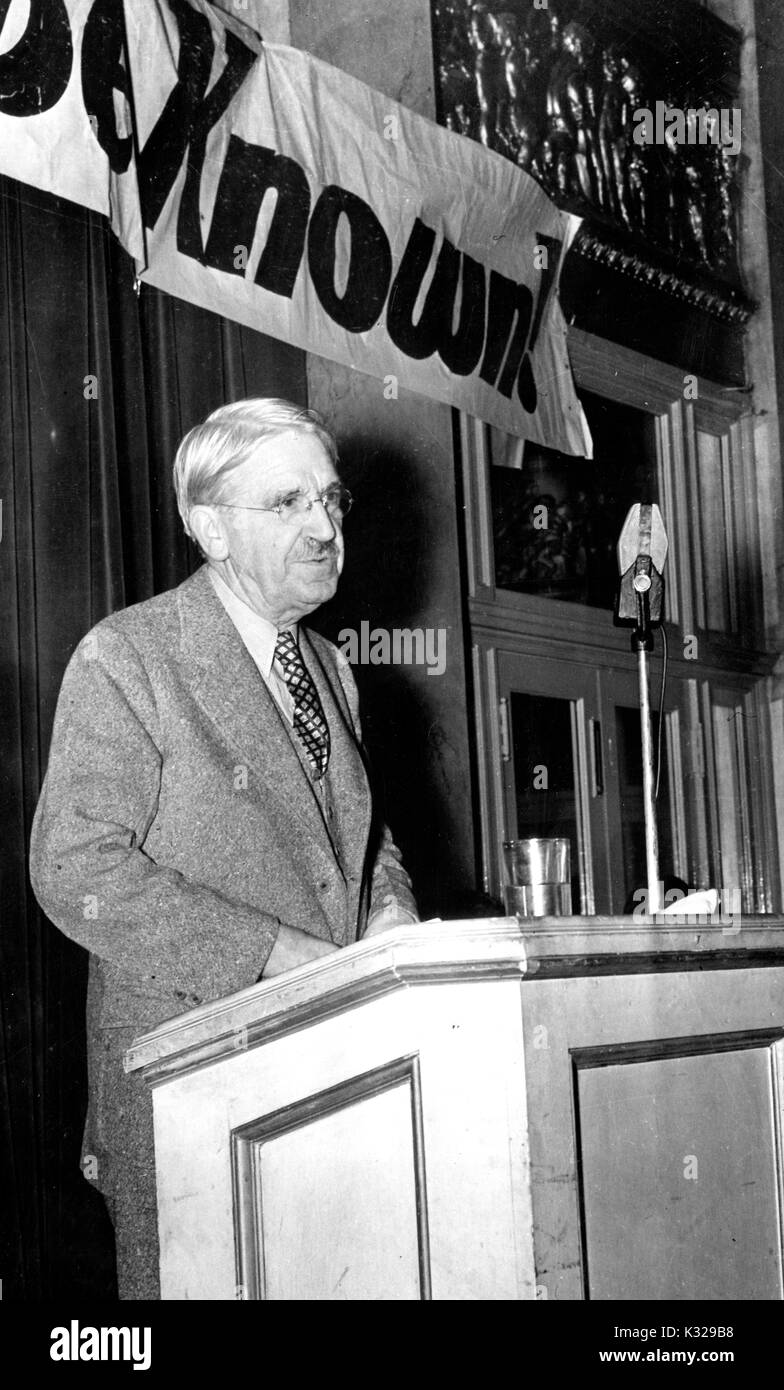 American philosopher, psychologist, and educational reformer John Dewey stands at a podium presenting Trotsky Commission findings, 1937. - Stock Image