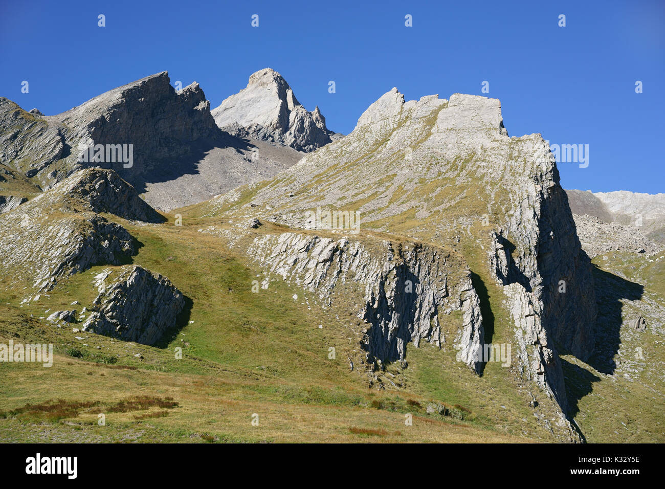 RUGGED LANDSCAPE ON THE ITALIAN SIDE OF PIC D'ASTI (3219m amsl). Above the village of Chianale, Province of Cuneo, Piedmont, Italy. - Stock Image