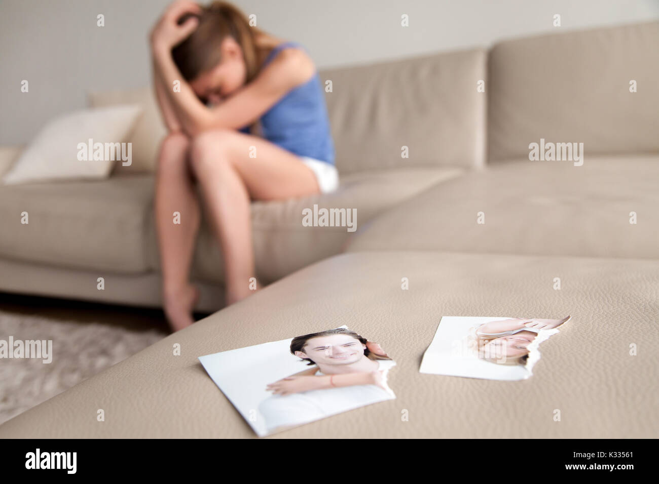 Lonely wife suffering after breakup at home - Stock Image