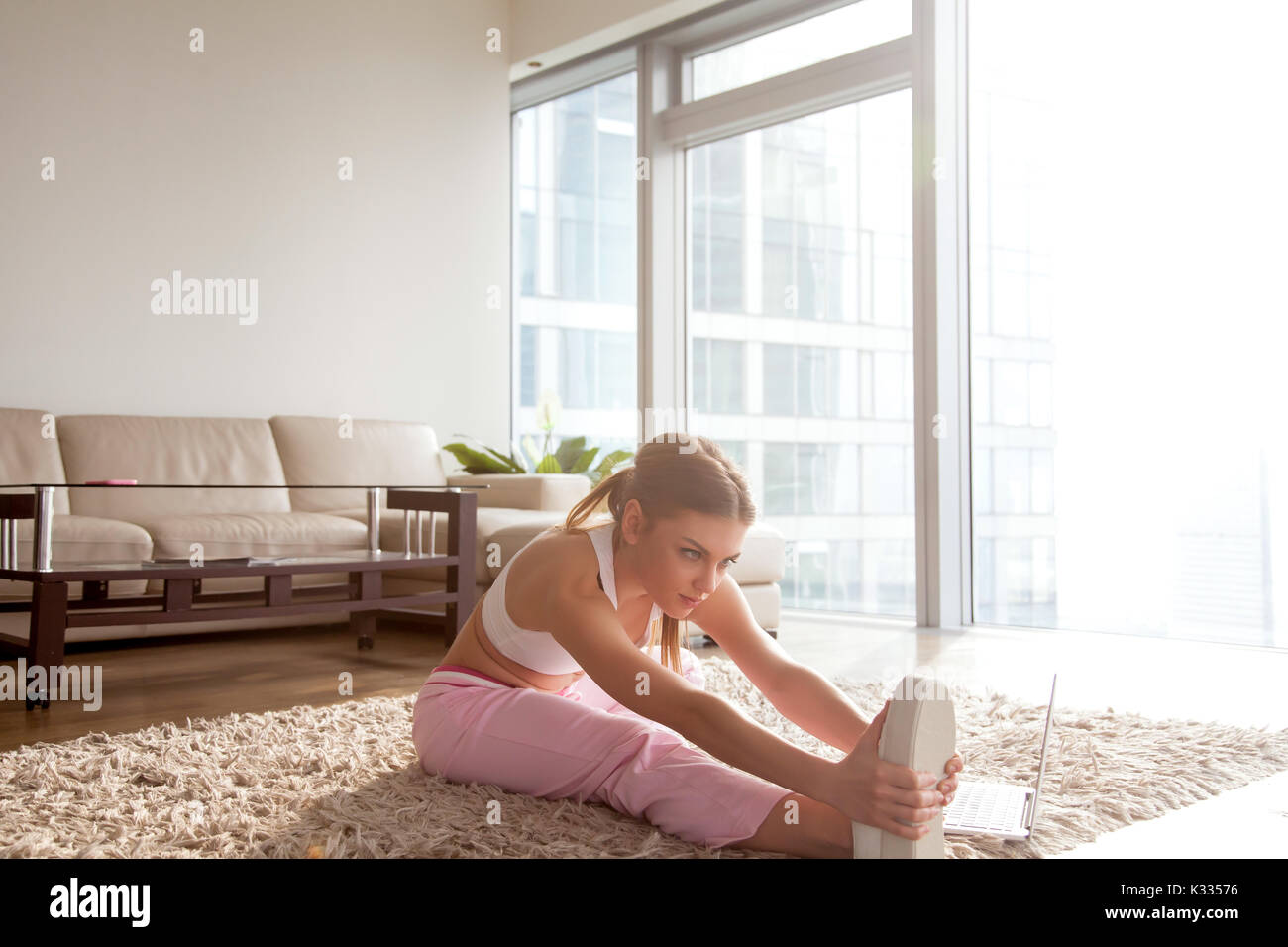 Woman doing exercise for flexibility increase - Stock Image