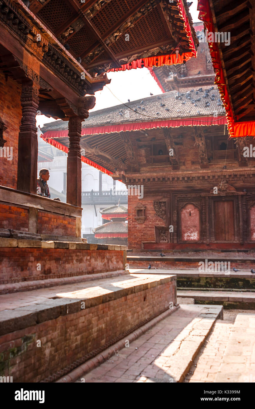 Alone man meditating in the temples of Kathmandu's Durbar square. - Stock Image