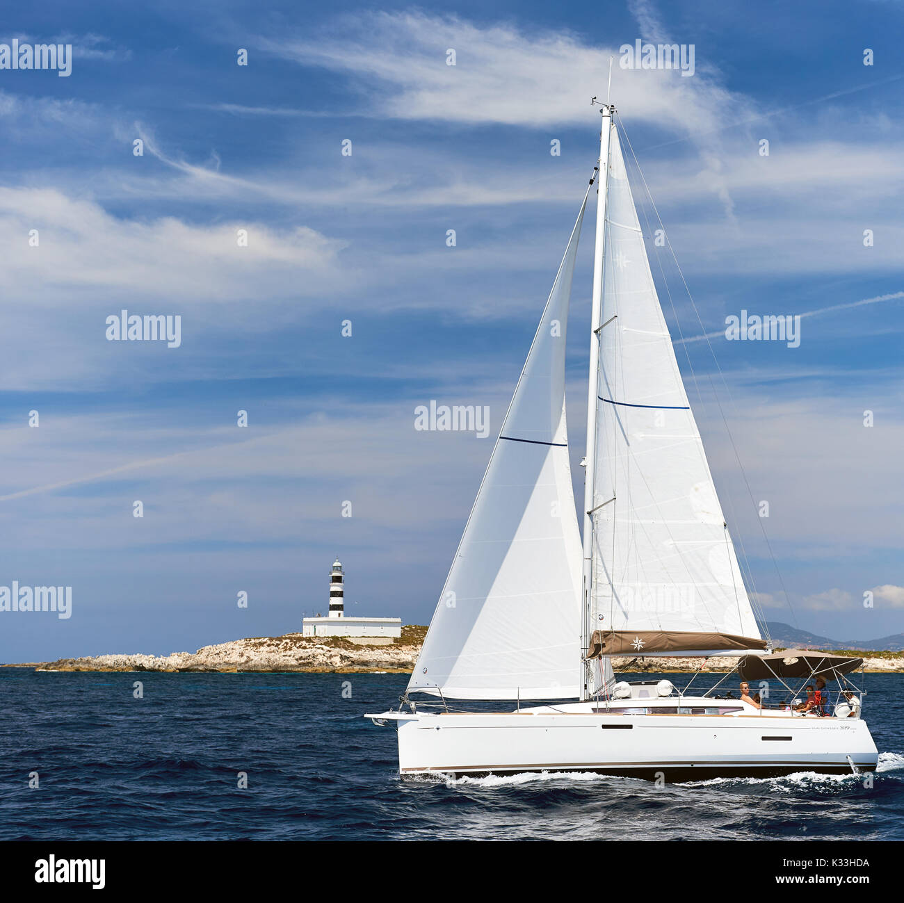 Ibiza, Spain - June 10, 2017: White sailboat Sun Odyssey 389 in the Mediterranean sea. Ibiza, Balearic Islands Spain - Stock Image