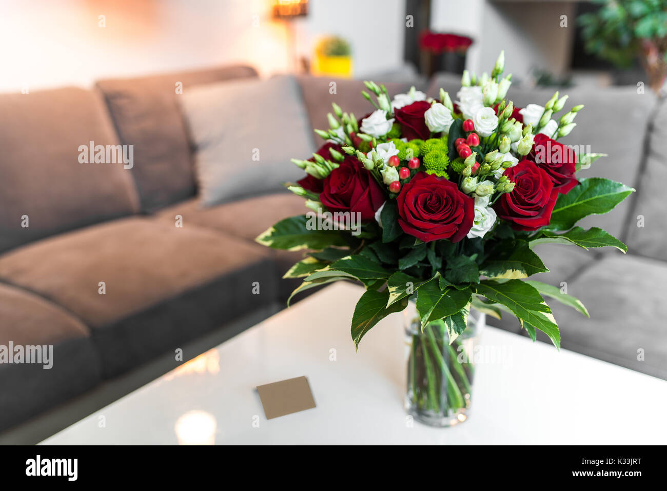 Bouquet of red roses standing on the white table in the saloon stock bouquet of red roses standing on the white table in the saloon izmirmasajfo Gallery