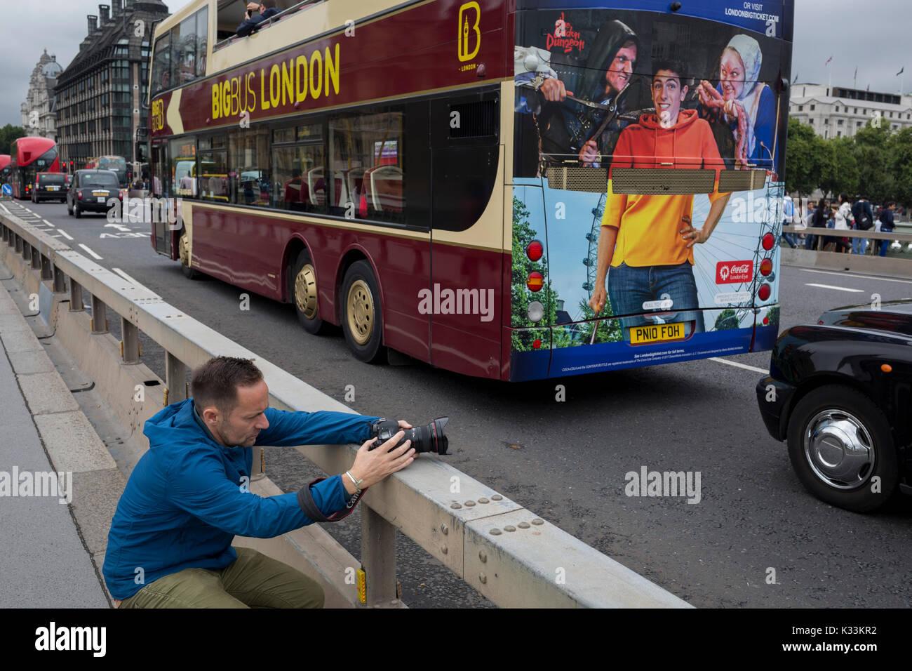 Photographer Jeremy Sutton-Hibbert, on Westminster Bridge, on 21st August 2017. - Stock Image