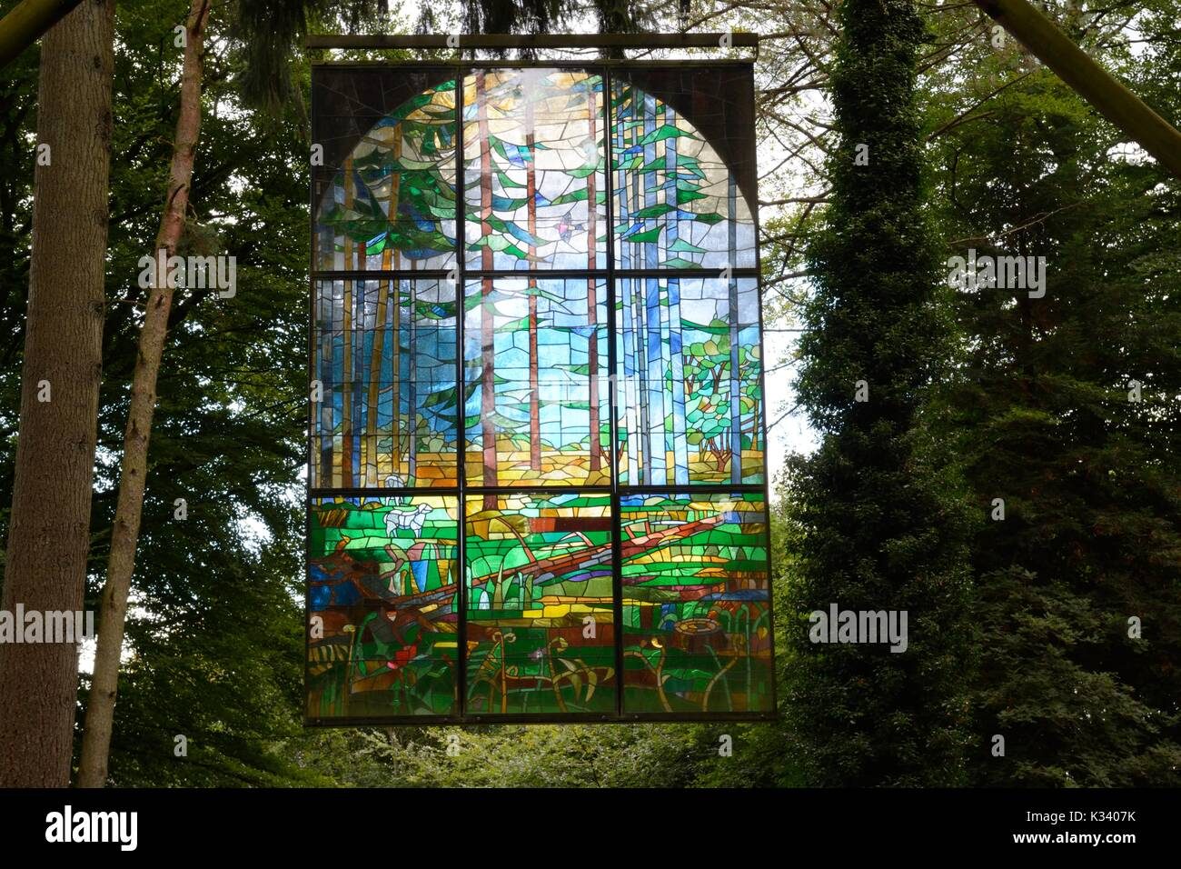 The Cathedral stained glass window  nade in 1986 depicting the life of the forest Forest of Dean Engleand UK GB - Stock Image