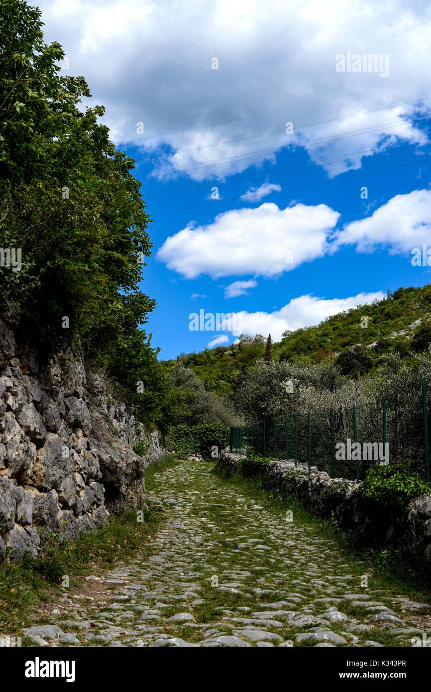 The Old Roman road near Riva del Garda, Italy - Stock Image