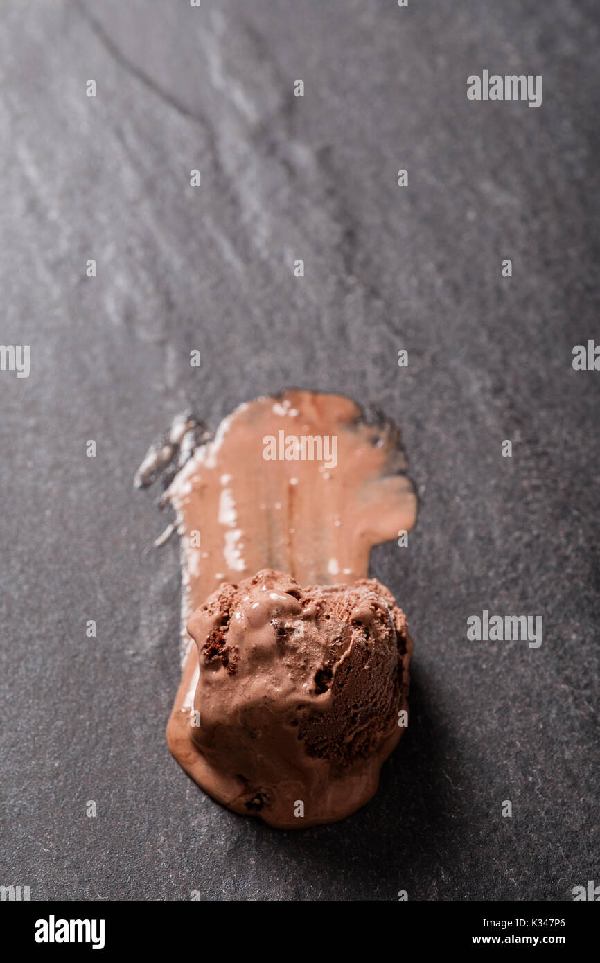 Melting Scoop of Chocolate Ice Cream on a Hot Summers Day - Stock Image