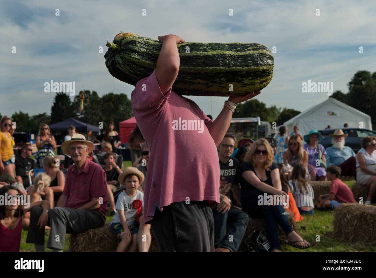 Village fete huge marrow being shown for auction, money for church fund, 2017 2010s HOMER SYKES - Stock Image