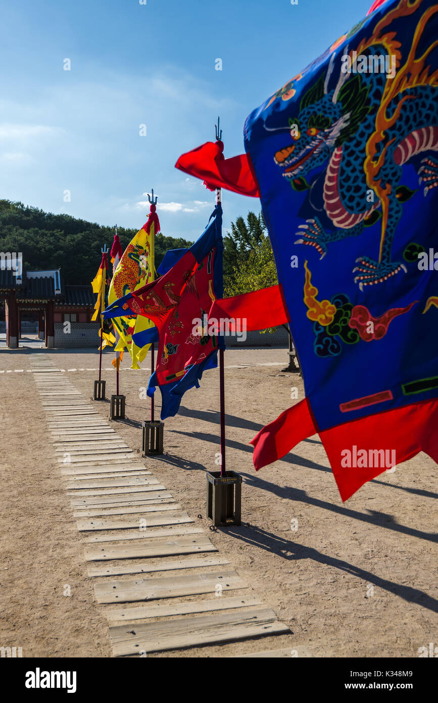 Seoul, Republic of Korea - 17.09.2015: Waving flags with dragon on it in Hwaseong Palace - Stock Image