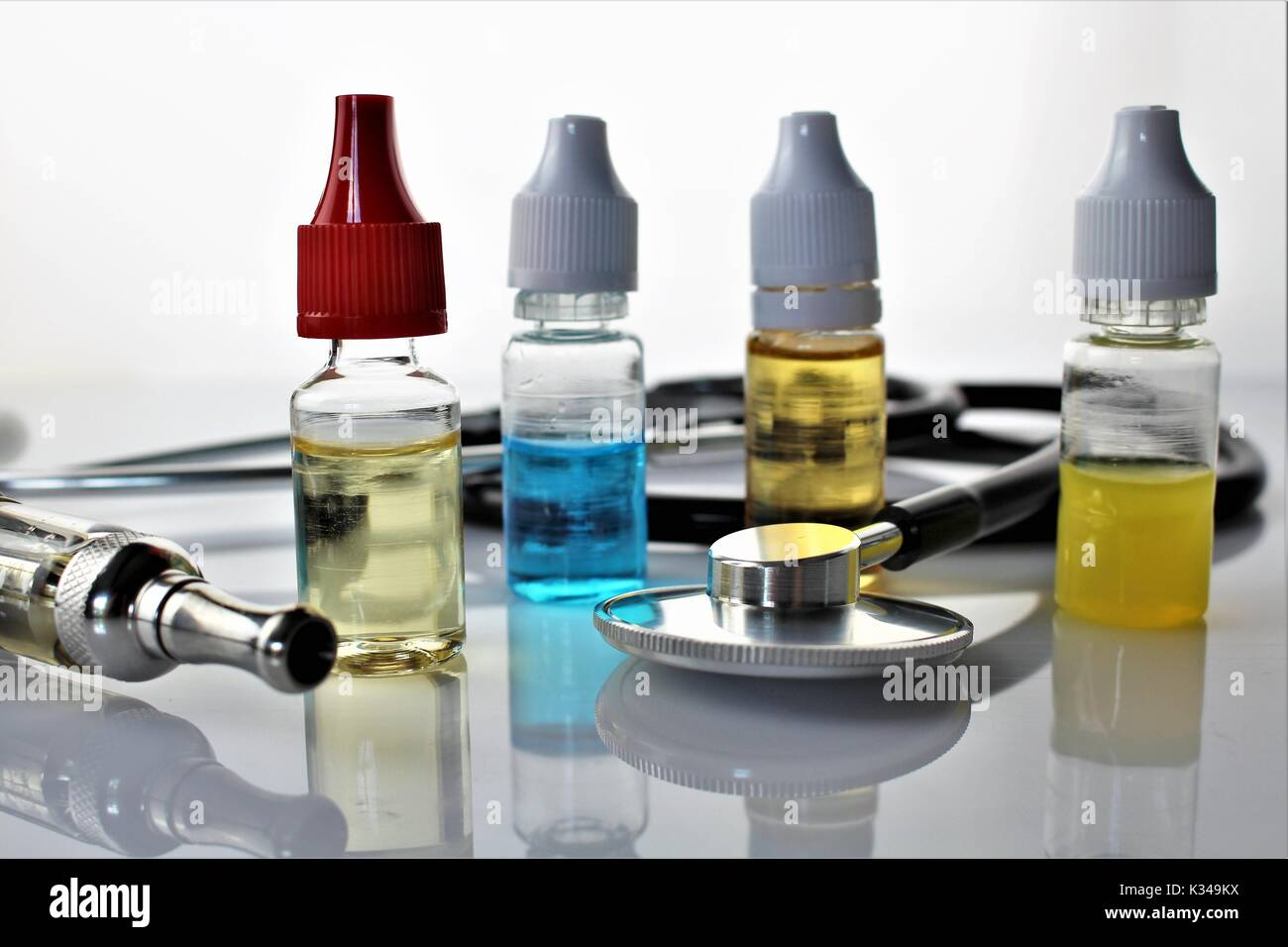 An image of a e-cigarette and a stethoscope - concept - Stock Image
