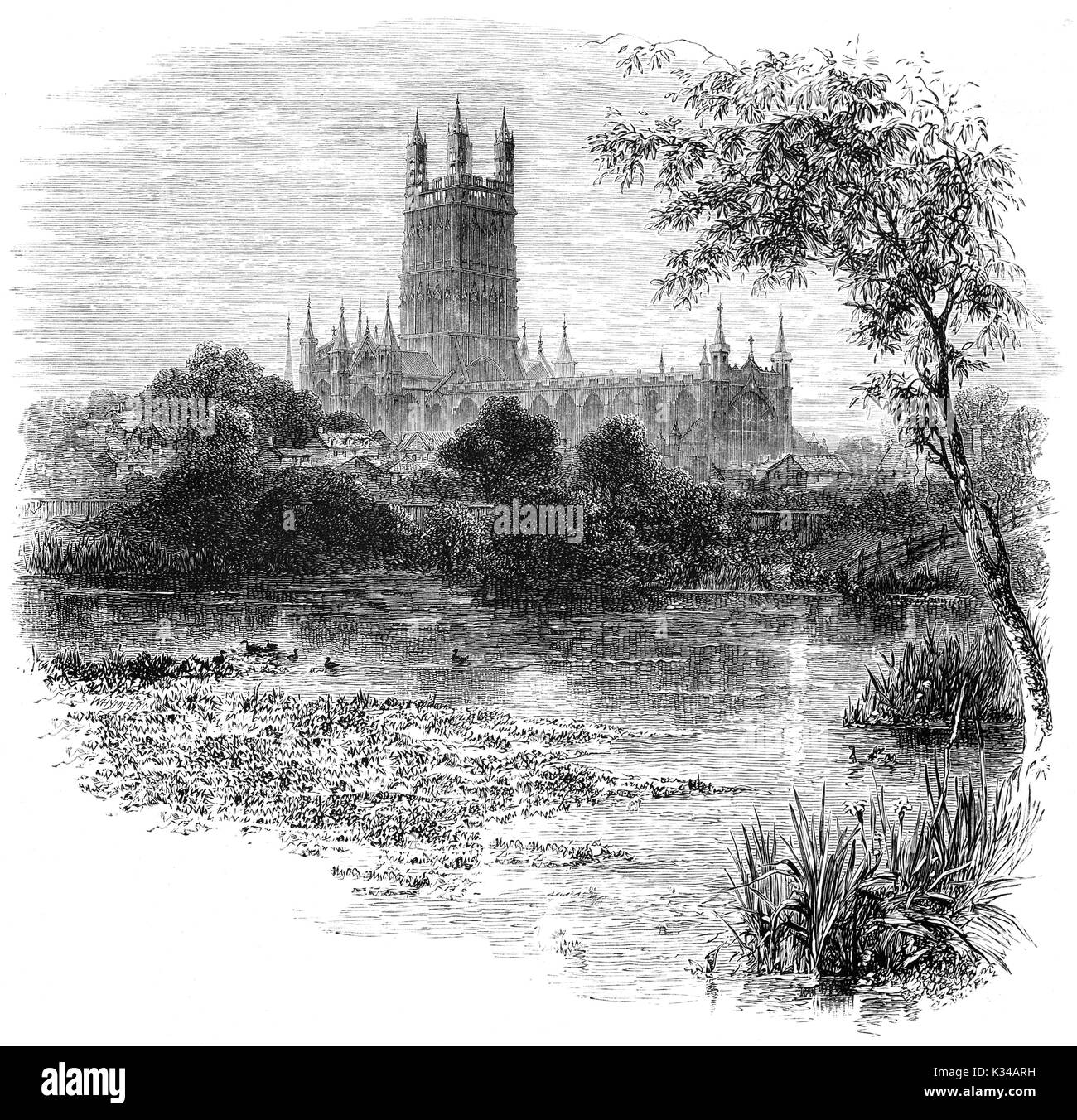 1870: Gloucester Cathedral, formally the Cathedral Church of St Peter and the Holy and Indivisible Trinity viewed from across  the River Severn. It originated in 678 or 679 and was dissolved by King Henry VIII. Gloucester, England. - Stock Image