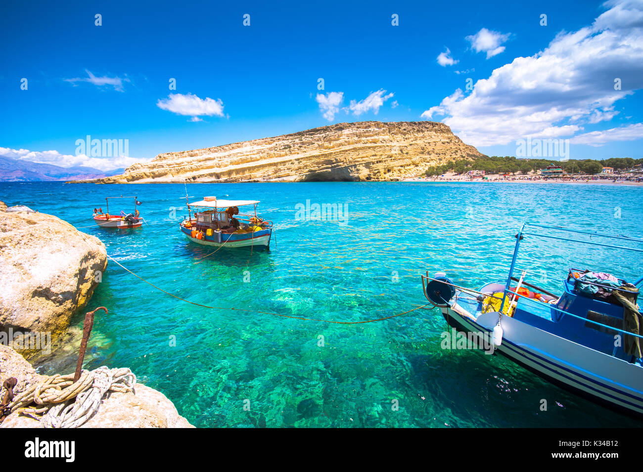 Matala beach with caves on the rocks that were used as a roman cemetery and at the decade of 70's were living hippies from all over the world, Crete, - Stock Image