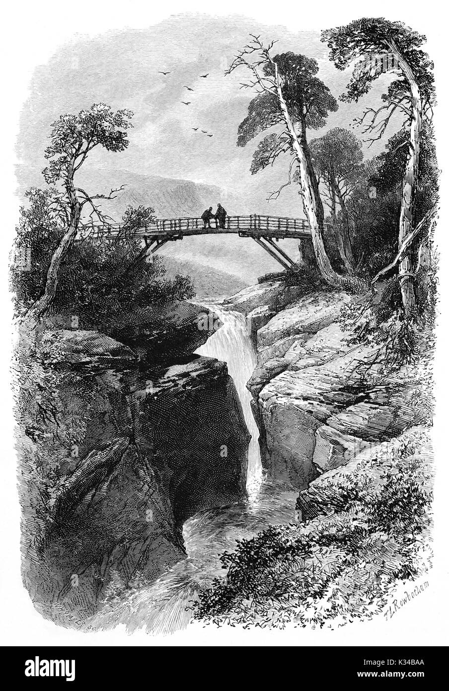 1870: Visitors on the bridge over the Linn O' Dee, a famous beauty spot, much favoured by Queen Victoria. The River Dee runs through a narrow channel and drops into rocky pools below.  Braemar, Aberdeenshire, Scotland - Stock Image