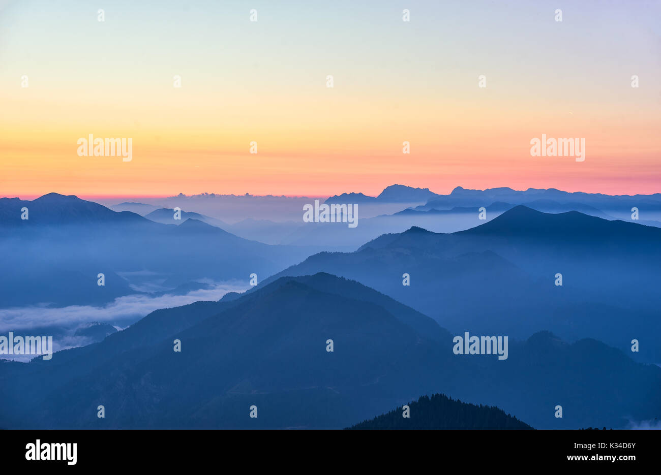 Picturesque red sunrise in austrian Alps - Stock Image