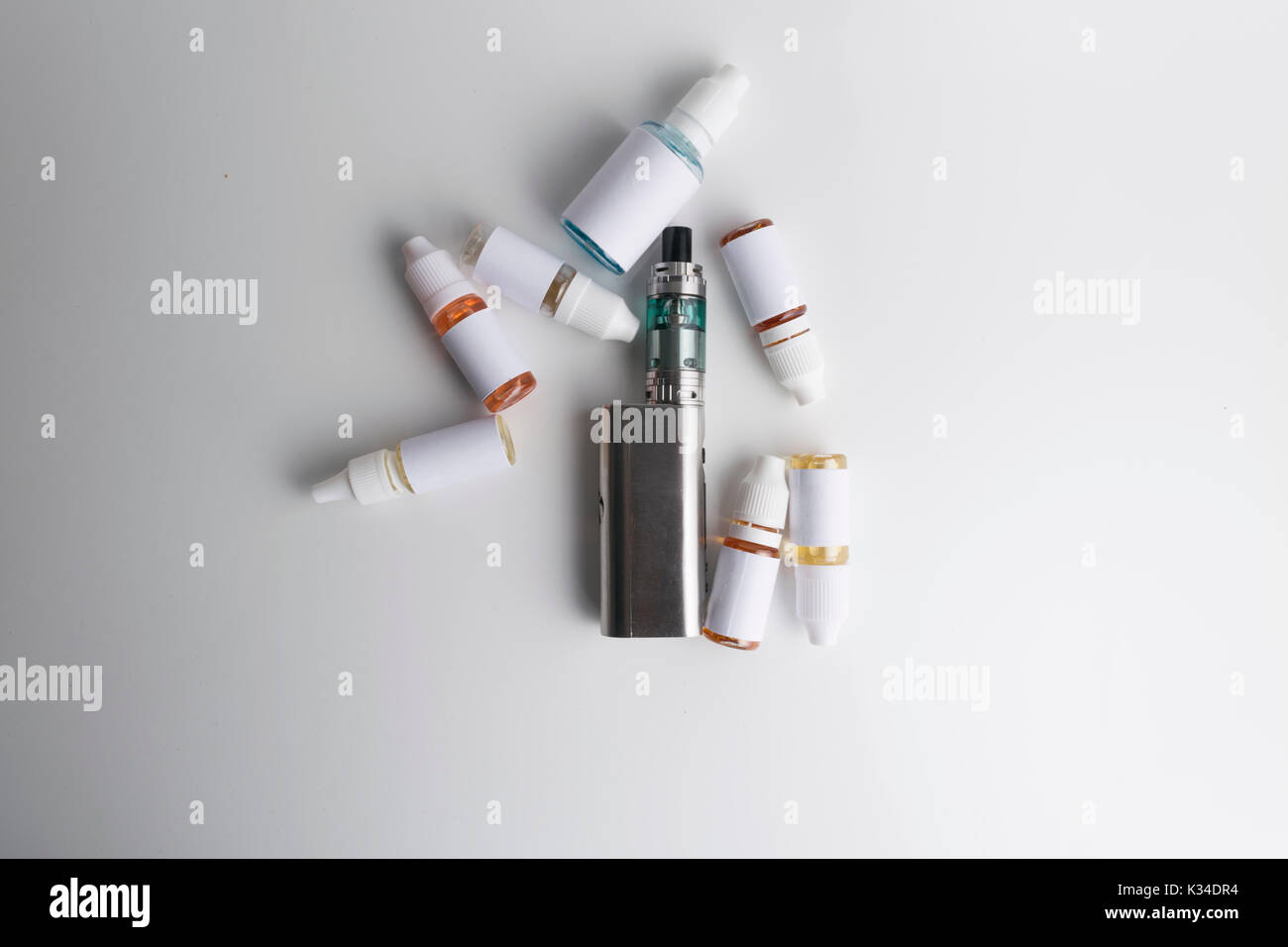 Isolated electronic cigarette with e-liquid or e-juice on a white background. - Stock Image