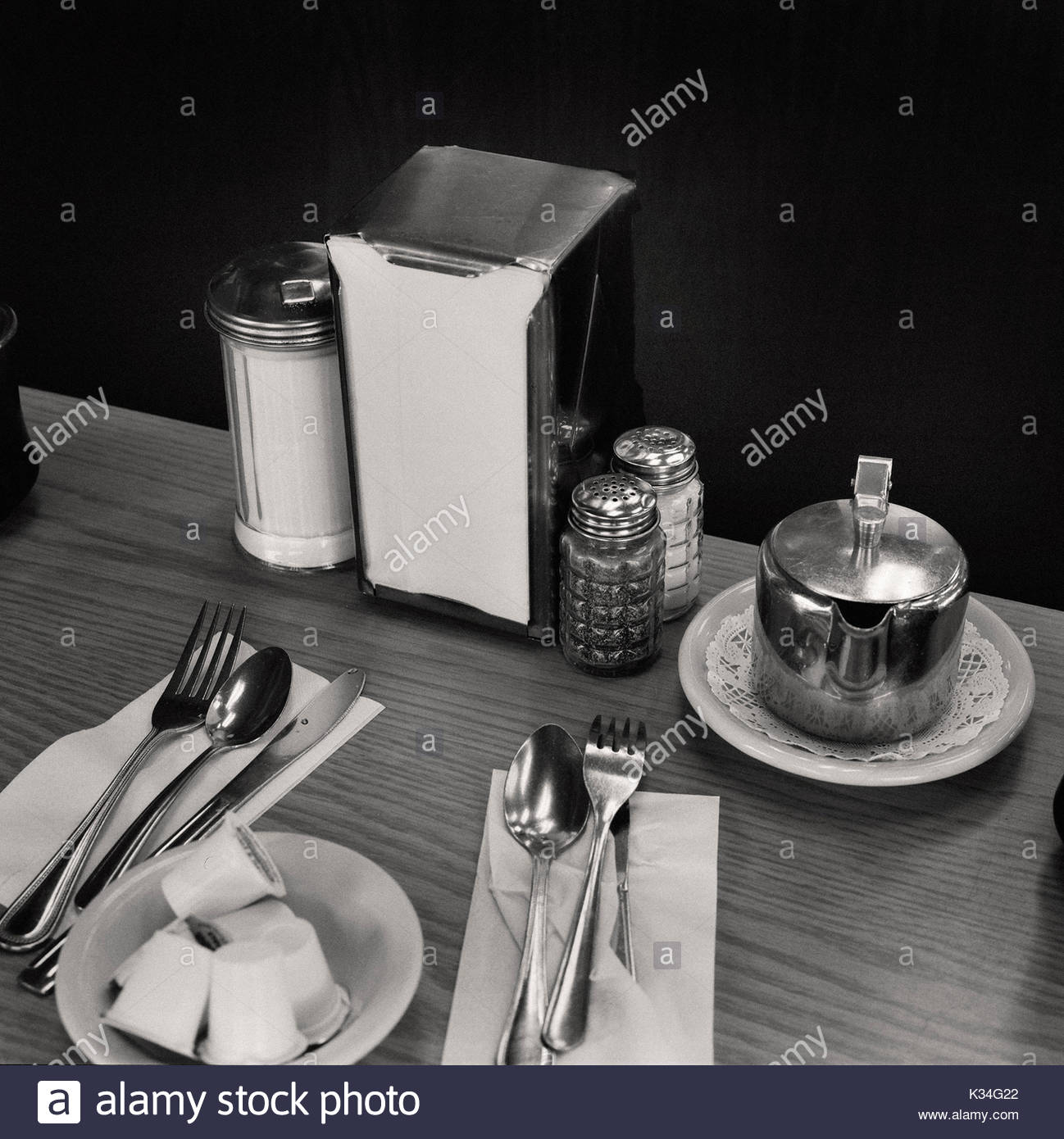 Coffee Shop Table with Place Settings - Stock Image