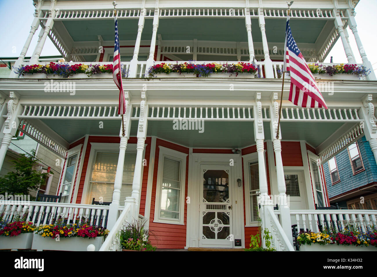 Queen Anne style Victorian home Architecture at beach Town Cape May, New Jersey. Front entrance with beautiful columns. - Stock Image