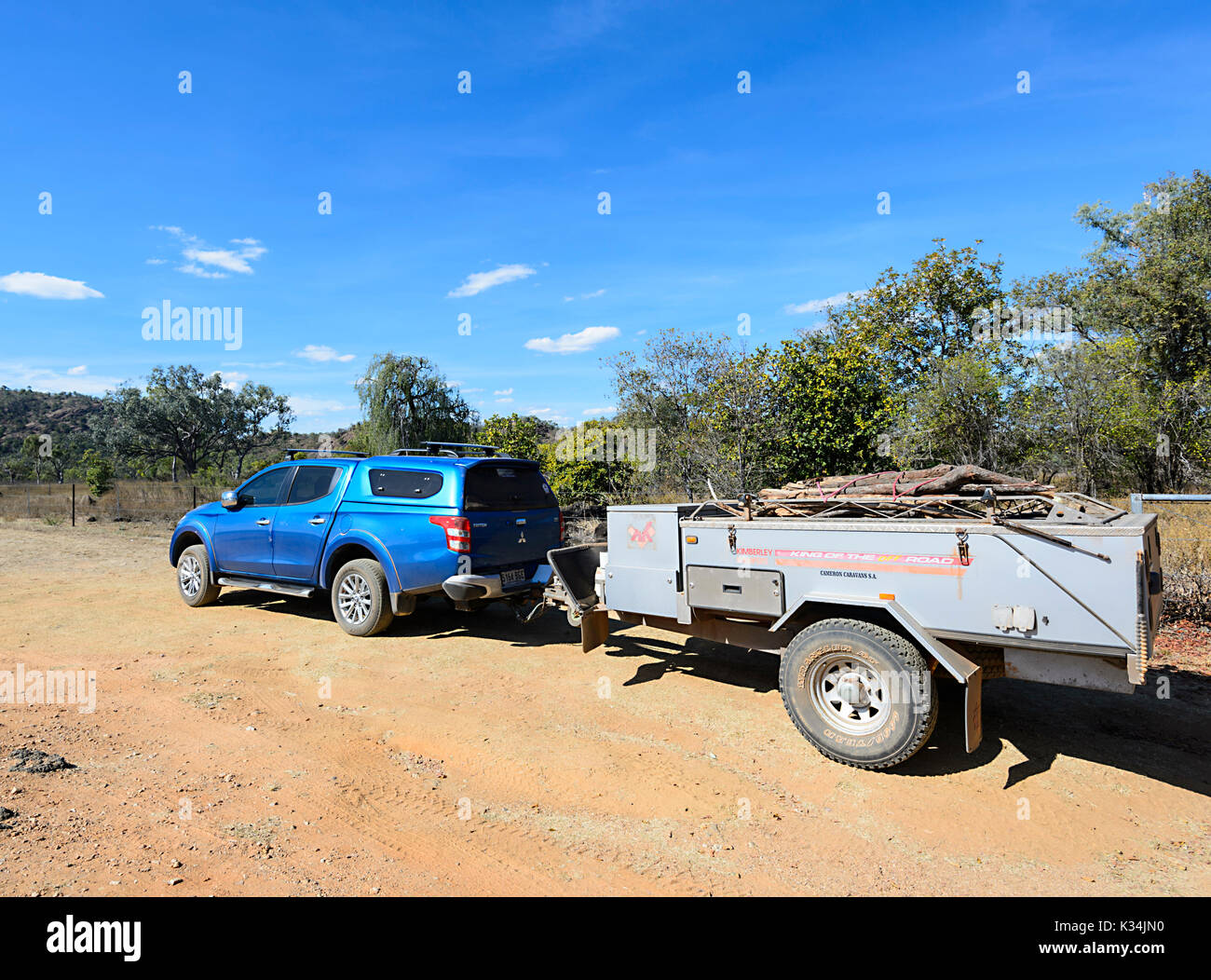 4x4 Mitsubishi Triton towing an off-road Kimberley Kampers camper trailer, Far North Queensland, FNQ, QLD, Australia - Stock Image