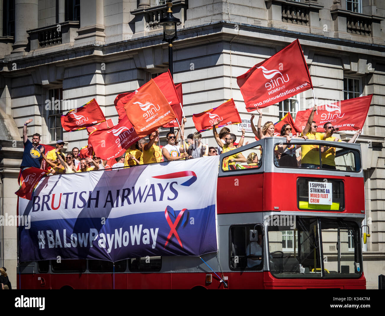BA British Airways Cabin Staff protest from a bus in Central London in a pay and conditions dispute with BA - Stock Image