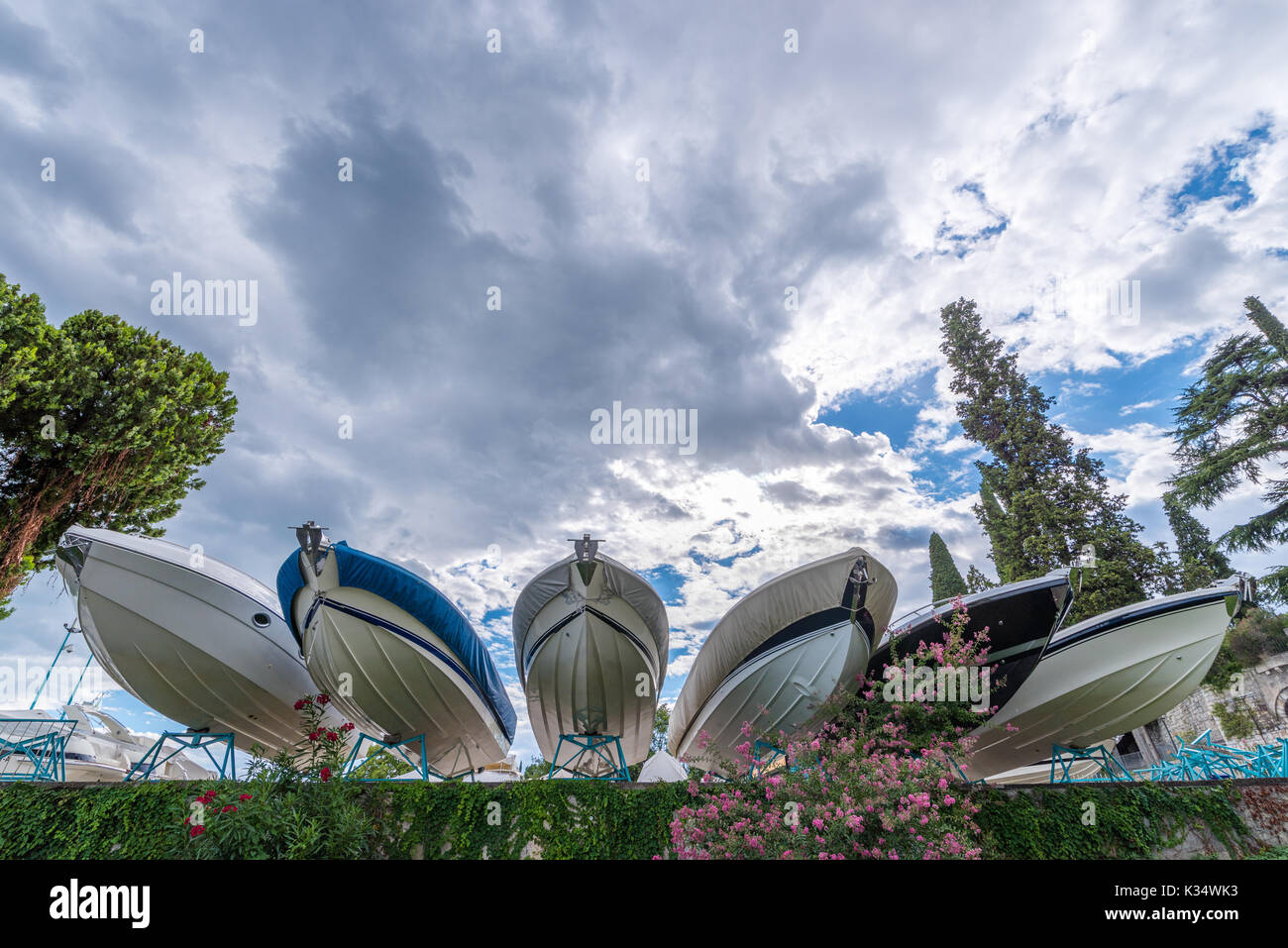 parked boats projected on bue sky  with white dramatic clouds. - Stock Image