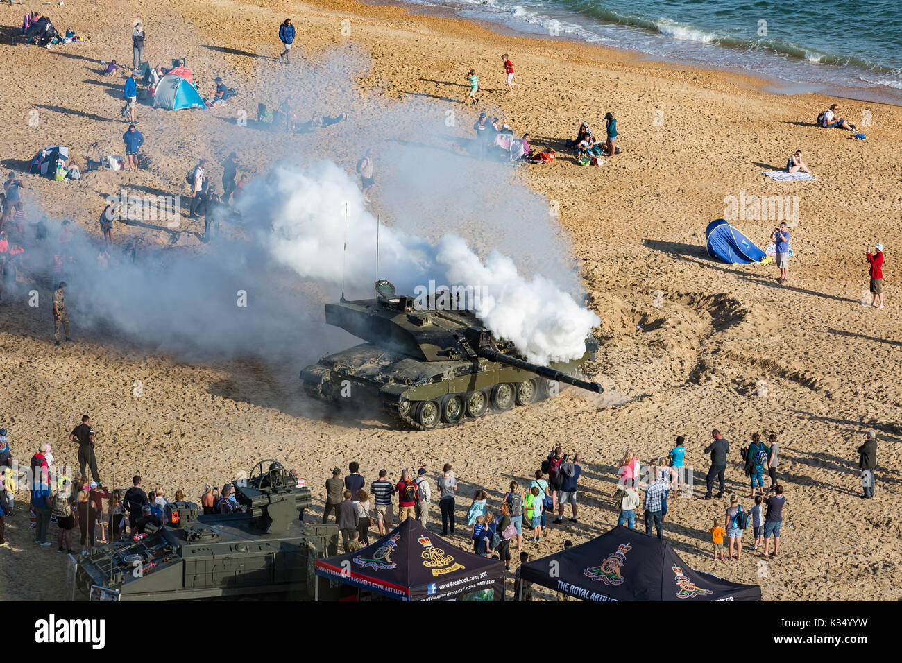 10th Anniversary of the Bournemouth Air Festival 2017, Tank displaying on the Sand, generating smoke as camouflage. - Stock Image