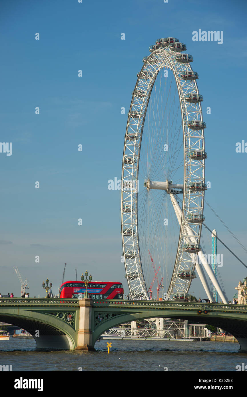 London Eye and Westminster Bridge with double decker London bus - Stock Image